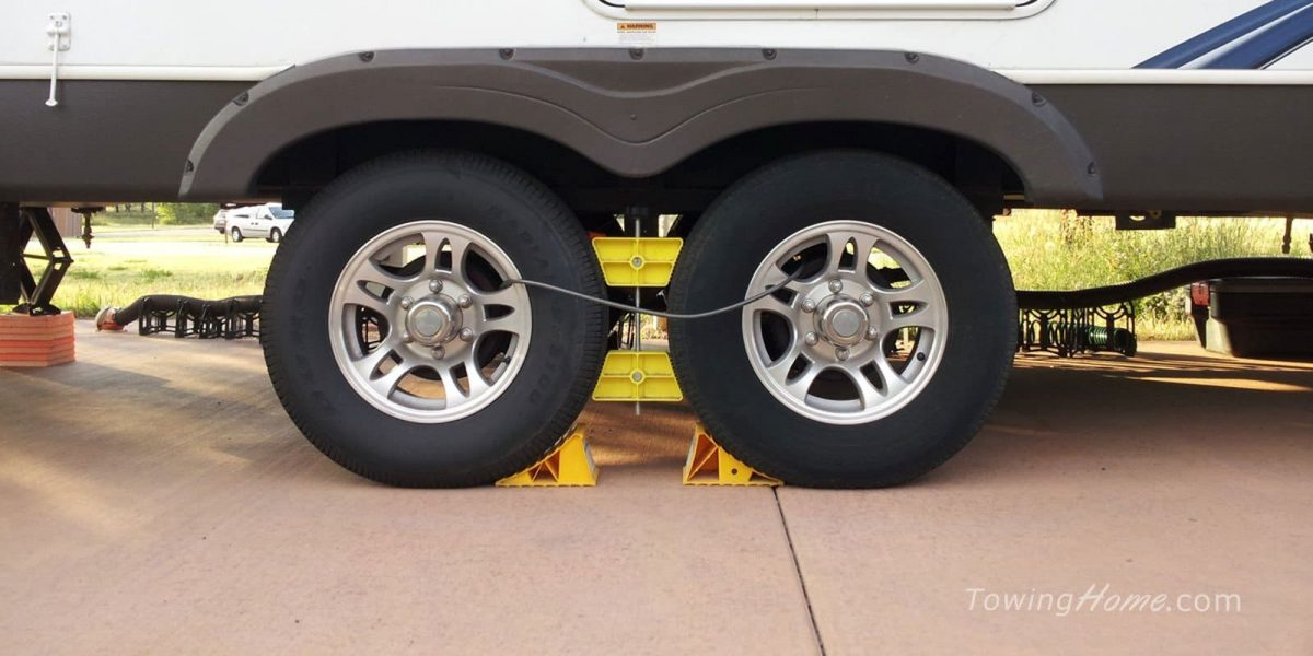 rv tires with cable lock and chocked wheels
